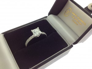 Princes cut engagement ring with diamond band