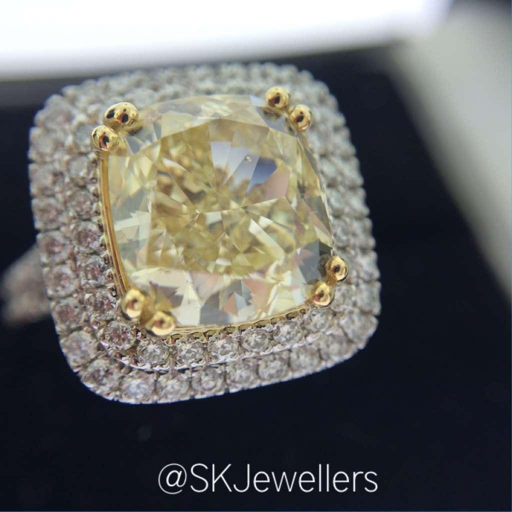 cushion cut fancy yellow diamond engagement ring