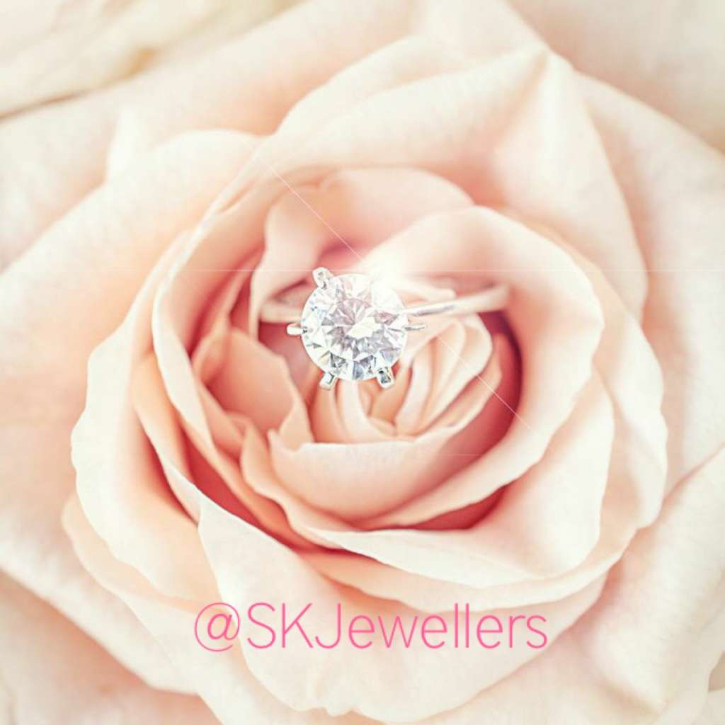 solitaire diamond engagement ring with pink rose
