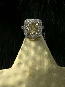 cushion cut yellow diamond halo engagnement ring