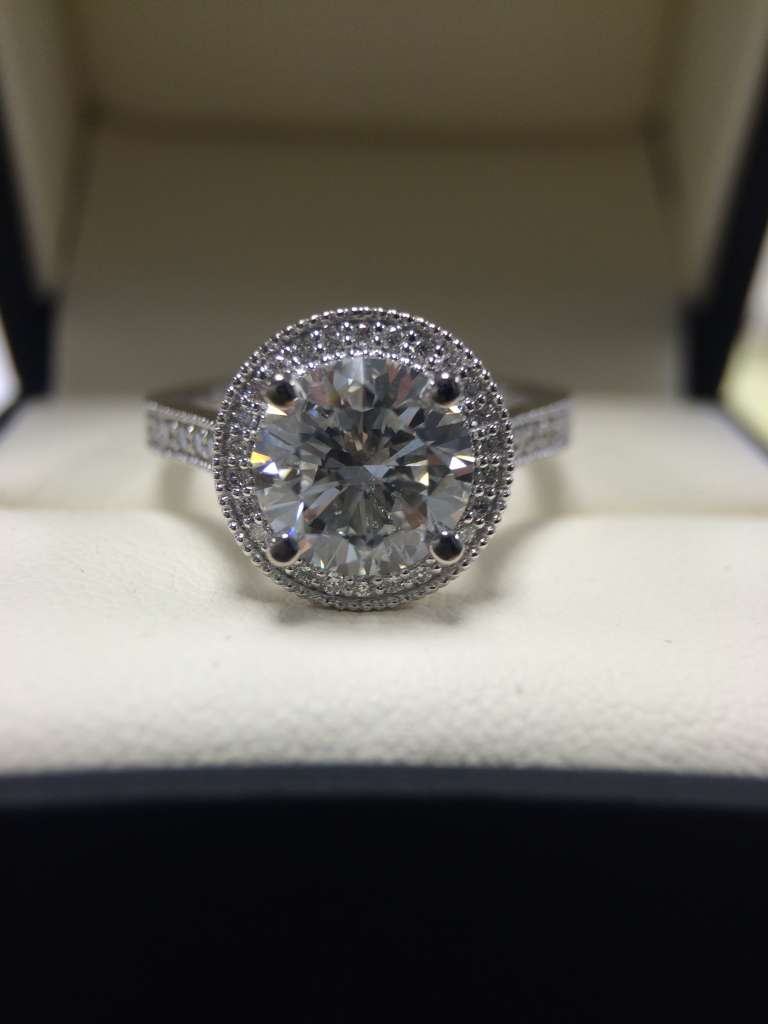 round diamond halo engagement ring with milgrain