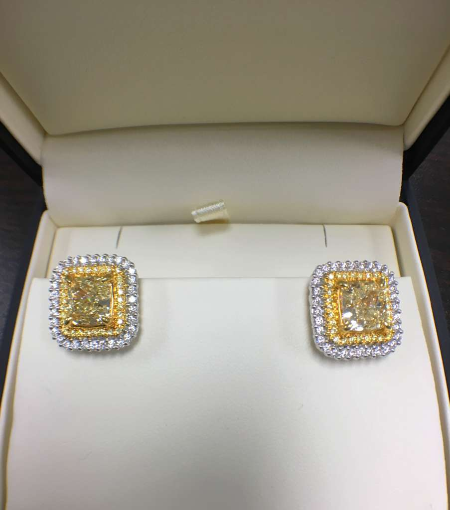 Fancy yellow diamond halo earrings