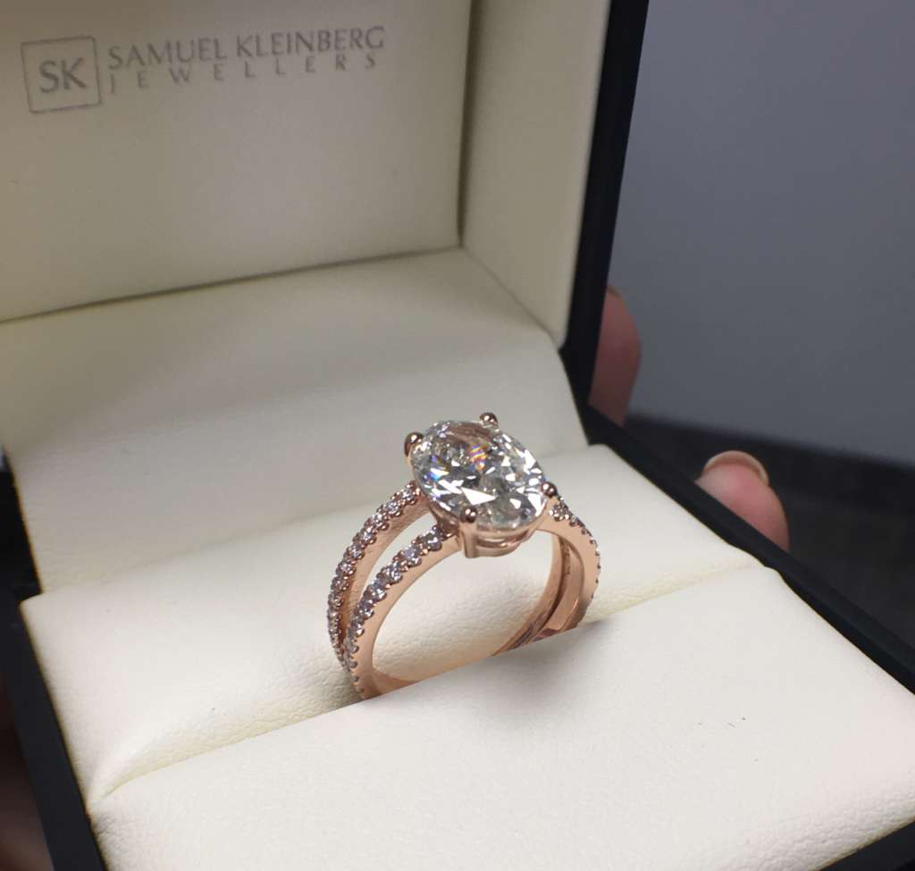 Rose gold oval engagement ring