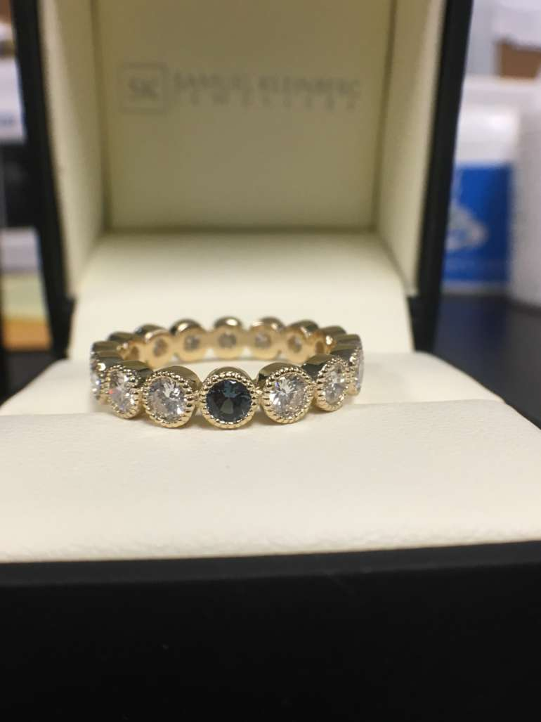 Alexandrite and diamond eternity ring
